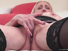 Granny kneads her phat hooters and jerks