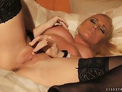 Glamourous cruel blonde trollop Kathia Nobili is masturbating near correct stockings